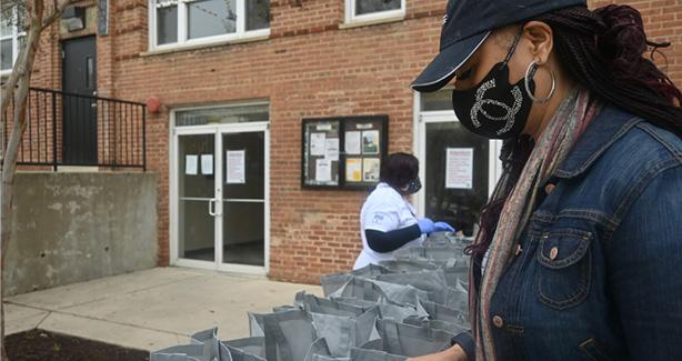 Photo of a person filling bags for the community